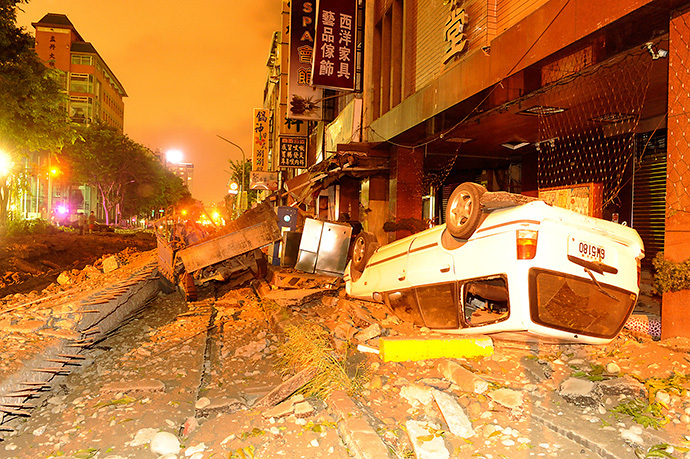 Wreckage of vehicles are seen amongst debris after an explosion in Kaohsiung, southern Taiwan, August 1, 2014. (Reuters / Stringer)
