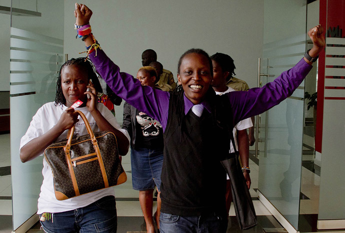 Members of Uganda's gay community and gay rights activists react as the constitutional court overturns anti-gay laws in Kampala on August 1, 2014. (AFP Photo)