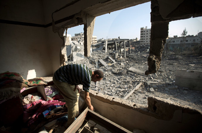 A Palestinian man inspects a destroyed home on August 2, 2014 following an overnight Israeli strike on Gaza City.(AFP Photo / Mahmud Hams)