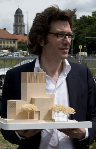 German architect Wilfried Kuehn holds a model of his design for the House of Prayer and Learning project, a multifaith prayer building, in Berlin (AFP Photo / John Macdougall)
