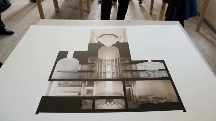 An illustration of German architect Wilfried Kuehn's design for the House of Prayer and Learning project, a multifaith prayer building, is on display during a presentation in Berlin (AFP Photo / John Macdougall)