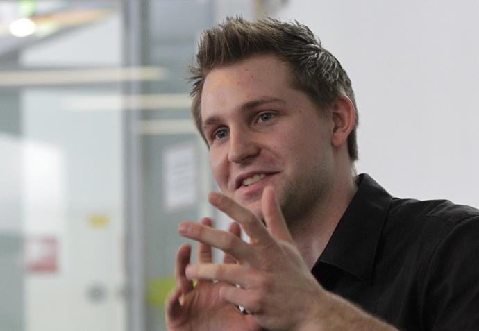 Law student Max Schrems briefs the media in Vienna (Reuters / Herwig Prammer)