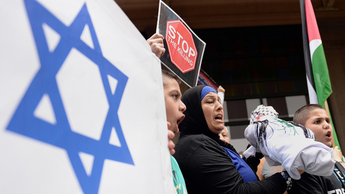 Protesters march in a rally in Sydney against Israel's military campaign in Gaza on August 3, 2014.(AFP Photo / Saeed Khan)