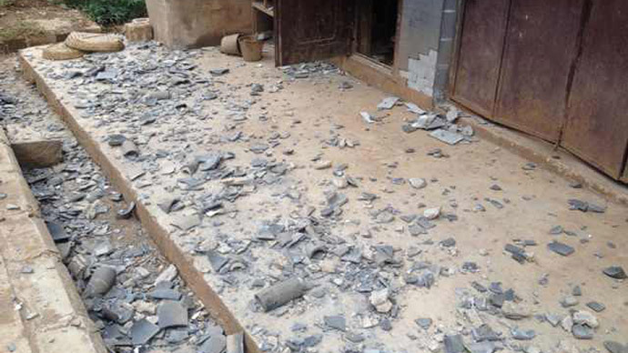 Broken tiles sit scattered on the ground after a 6.1 magnitude earthquake hit the area in Ludian county in Zhaotong, southwest China's Yunnan province on August 3, 2014.(AFP Photo / China Out)