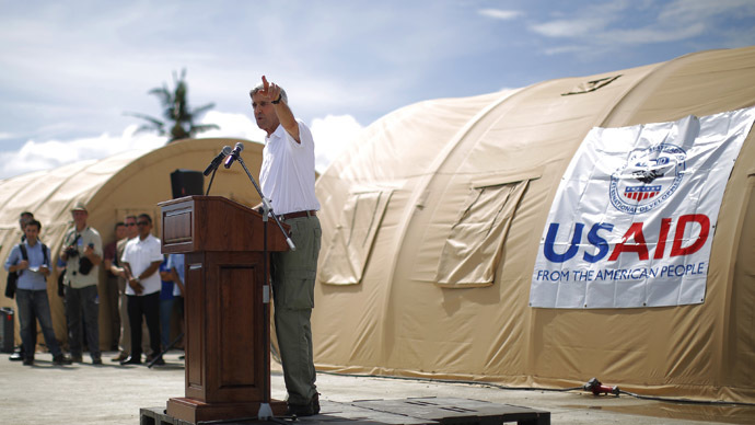 U.S. Secretary of State John Kerry delivers remarks during a tour of the damage from super typhoon Haiyan in Tacloban December 18, 2013. (Reuters)