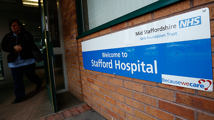 A woman leaves the Stafford Hospital in central England (Reuters / Darren Staples)