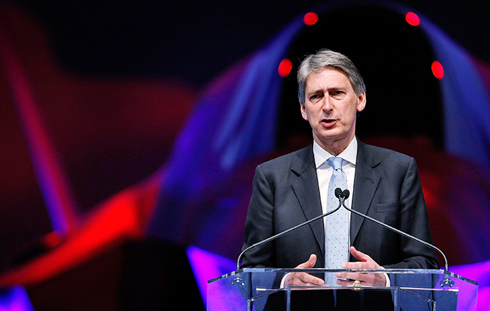 British Foreign Secretary, Philip Hammond, acknowledges that the EU's sanctions against Russia may hinder Britain's economic interests, but suggests such measures are necessary. (AFP Photo / Tom Pennington)