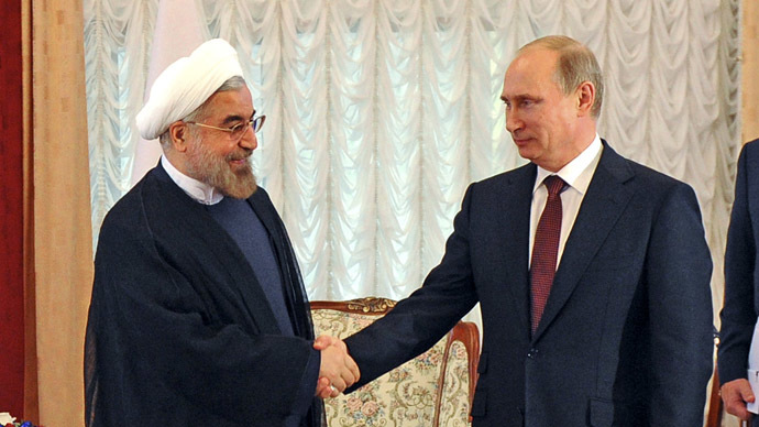 Russia's President Vladimir Putin (2nd L) shakes hands with his Iranian counterpart Hassan Rouhani (L) (Reuters/Mikhail Klimentyev)