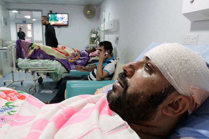Shi'ite volunteers with the Iraqi Army, lie in hospital beds after being wounded in clashes with militants of the Islamic state, formerly known as the Islamic state in Iraqi and the Levant (ISIL), in Basra, southeast of Baghdad, August 6, 2014 (Reuters / Essam Al-Sudani)