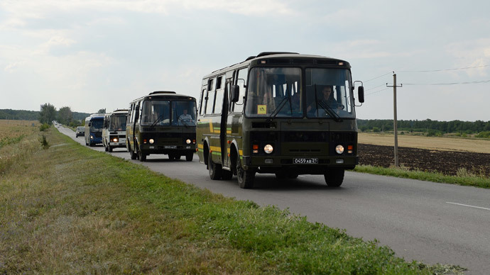A truck convoy with Ukrainian soldiers on the way from the Rostov Region to Ukraine.(RIA Novosti / Maksim Blinov)