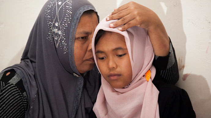 'It's a miracle': Indonesian girl missing after 2004 tsunami reunites with family