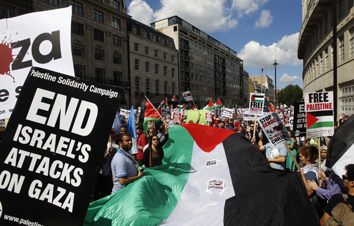 Demonstrators march to support the people of Gaza, in central London August 9, 2014. (Reuters/Luke MacGregor)