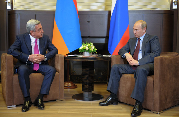 Russian President Vladimir Putin (right) has a bilateral meeting with Armenian President Serzh Sargsyan in Bocharov Ruchey residence.(RIA Novosti / Alexei Druzhinin)