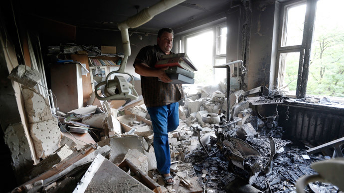 A man inspects wreckage inside a damaged building following what locals say was shelling by Ukrainian forces in Donetsk August 7, 2014.(Reuters / Sergei Karpukhin )
