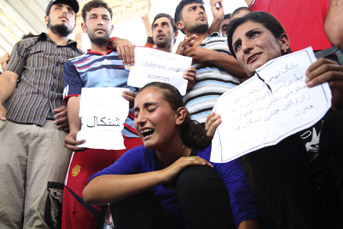 Displaced demonstrators from the minority Yazidi sect gather during a protest against militants of the Islamic State, formerly known as the Islamic State in Iraq and the Levant (ISIL), in Arbil, north of Baghdad (Reuters / Azad Lashkari)