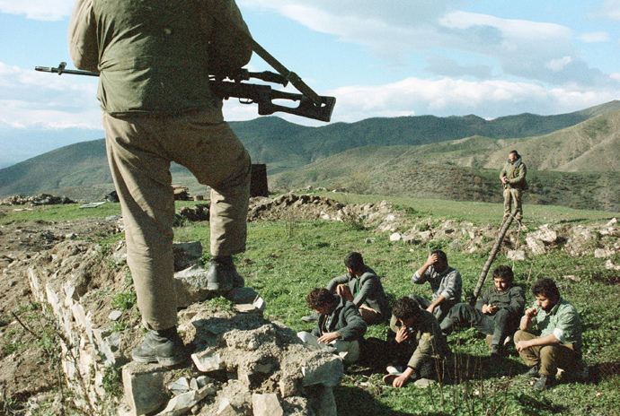 An Azeri soldier guards Armenians detained in the village Spitakesh on June 1, 1989 in Karabakh, Azerbaijan (RIA Novosti / Sergey Titov)