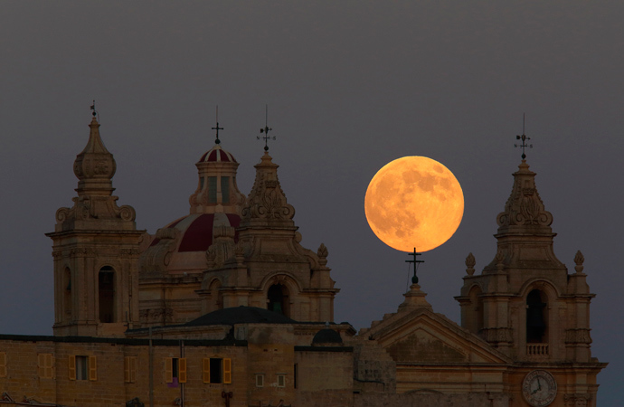 The supermoon rises behind the cathedral in Mdina, Malta's ancient capital city, in the centre of the island, August 10, 2014 (Reuters / Darrin Zammit Lupi)