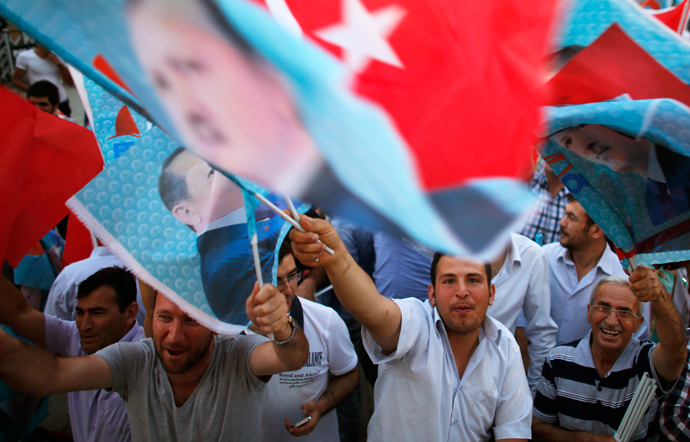 Supporters of Turkey's Prime Minister Tayyip Erdogan celebrate his election victory in front of the party headquarters in Ankara August 10, 2014 (Reuters / Umit Bektas)