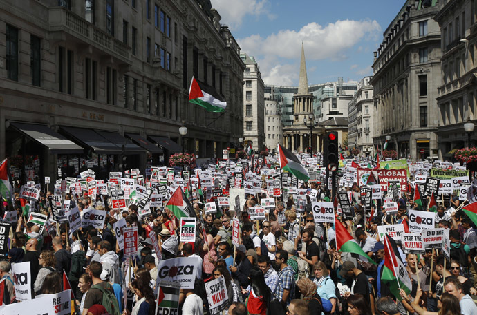 Demonstrators join a rally to support the people of Gaza, in central London August 9, 2014. (Reuters/Luke MacGregor)