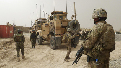 Afghan, US officials sign long-awaited pact to ensure troops stay past 2014