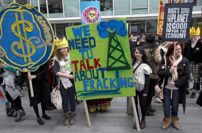 British demonstrators hold banners during an anti-fracking protest in central London on March 19 2014. (Reuters/Neil Hall)
