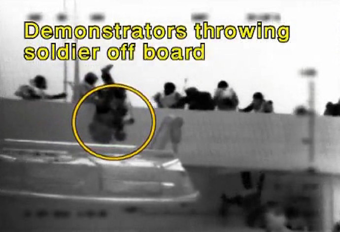 "An image grab taken from a video released by the Israeli navy shows, according to the Israeli military, passengers of Turkish aid ship Mavi Marmara, one of the ships in the ""Freedom Flotilla"", throwing an Israeli soldier off board on May 31, 2010 during a pre-dawn assault in international waters which killed several pro-Palestinian activists and sparked global outrage, plunging the Jewish state into a diplomatic crisis. (AFP/IDF)"