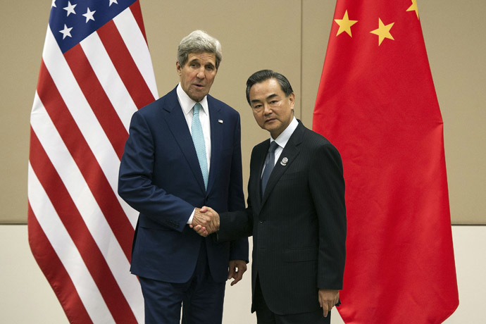 U.S. Secretary of State John Kerry shakes hands with Chinese Foreign Minister Wang Yi during a ASEAN Regional Forum at Myanmar International Convention Centre (MICC) in Naypyitaw August 9, 2014. (Reuters/Nicolas Asfouri)