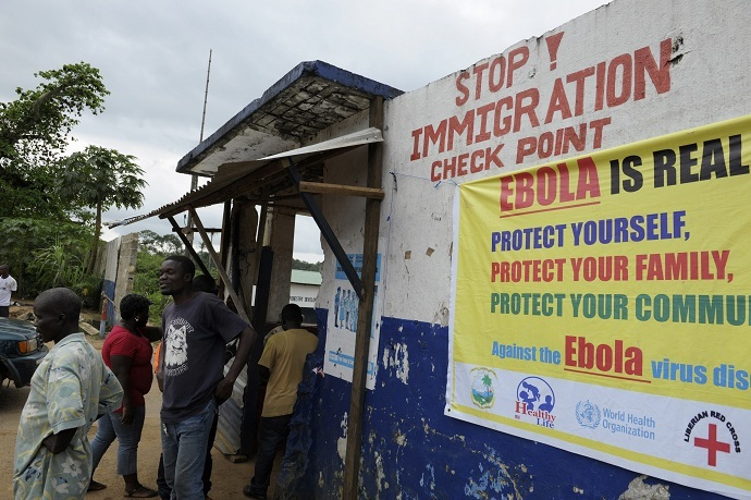 Liberian soldiers check people travelling in Bomi County. Liberian troops set up Ebola roadblocks and stopped public access to some of the worst-hit towns after the country declared a state of emergency to tackle the worst outbreak of the disease on record. (Reuters/Stringer)