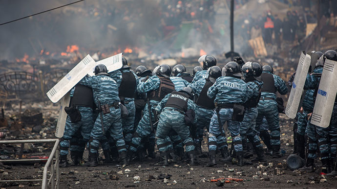 Police officers are seen on Maidan Nezalezhnosti square in Kiev, where clashes began between protesters and the police on February 19, 2014. (RIA Novosti / Andrey Stenin)