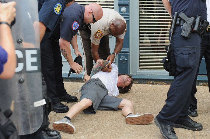 A man is arrested during a protest of the shooting death of 18-year-old Michael Brown outside Ferguson Police Department Headquarters August 11, 2014 in Ferguson, Missouri. (Michael B. Thomas / Getty Images / AFP)