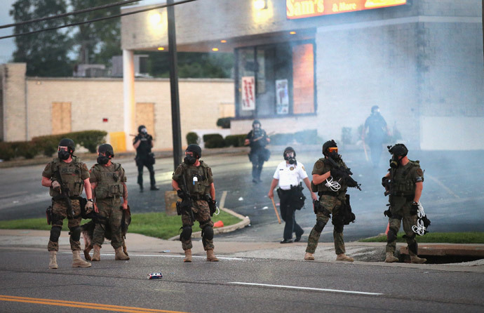 Tear gas hangs in the air as police force protestors from the business district into nearby neighborhoods on August 11, 2014 in Ferguson, Missouri. (Scott Olson / Getty Images / AFP)