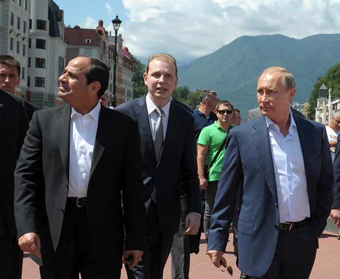 Russian President Vladimir Putin (R) and his Egyptian counterpart Abdel Fattah al-Sisi (L) walk on the main embankment in the Roza Khutor Village outside Sochi on August 12, 2014 during the Egyptian leader's first official visit to Russia. (AFP Photo / Alexei Druzhinin)
