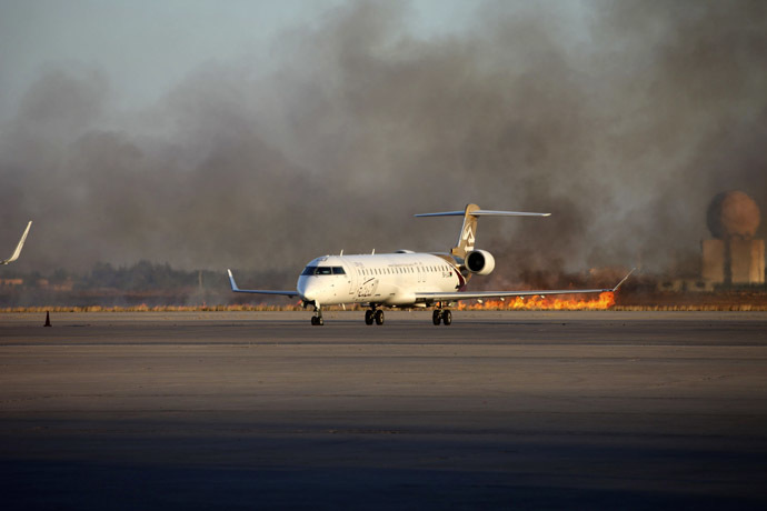 Smoke rises after a shelling at Tripoli International Airport July 15, 2014. (Reuters/Hani Amara)