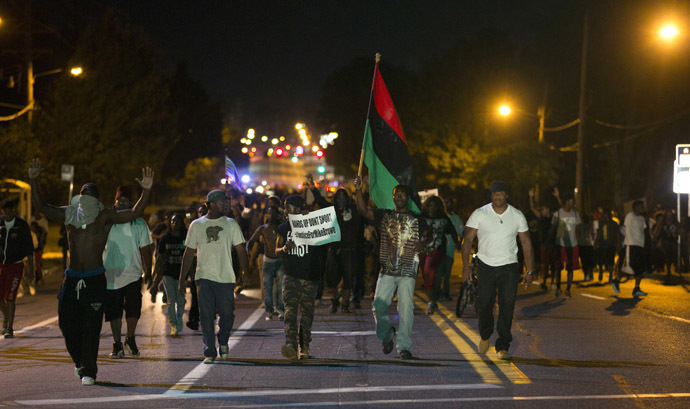 Demonstrators march in the street while protesting the shooting death of black teenager Michael Brown in Ferguson, Missouri August 12, 2014. (Reuters)