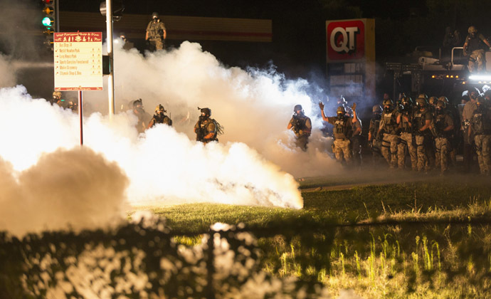 Riot police clear a street with smoke bombs while clashing with demonstrators in Ferguson, Missouri August 13, 2014. (Reuters)