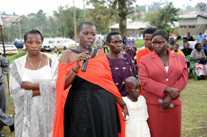 Gloria Tumwijuke (with microphone), Alice Ngonzi Isoke (folding hands in red dress), Diana Alinaitwe (behind Alice), Mrs Isoke (Alice's mother), an unidentified health worker(on Gloria's right) and a granddaughter to Mrs Isoke – all Ebola survivors narrating their ordeal at Kagaadi Hospital during the function to officially declare Uganda Ebola free (Photo from www.afro.who.int)