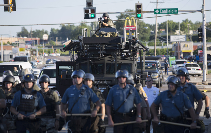 Riot police stand guard as demonstrators protest the shooting death of teenager Michael Brown in Ferguson, Missouri August 13, 2014. (Reuters / Mario Anzuoni)