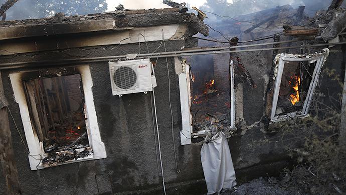 A house burnt during artillery bombardment in Donetsk. (RIA Novosti / Maks Vetrov)