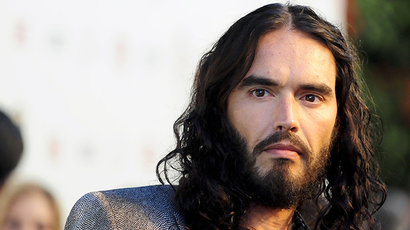 'Revolution is inevitable': Russell Brand hits Wall Street, kisses RT interviewer (VIDEO)