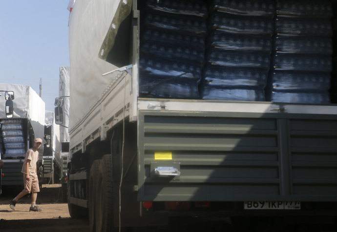A driver walks past Russian convoy of trucks carrying humanitarian aid for Ukraine at a camp near Kamensk-Shakhtinsky, Rostov Region, August 15, 2014. (Reuters/Maxim Shemetov)