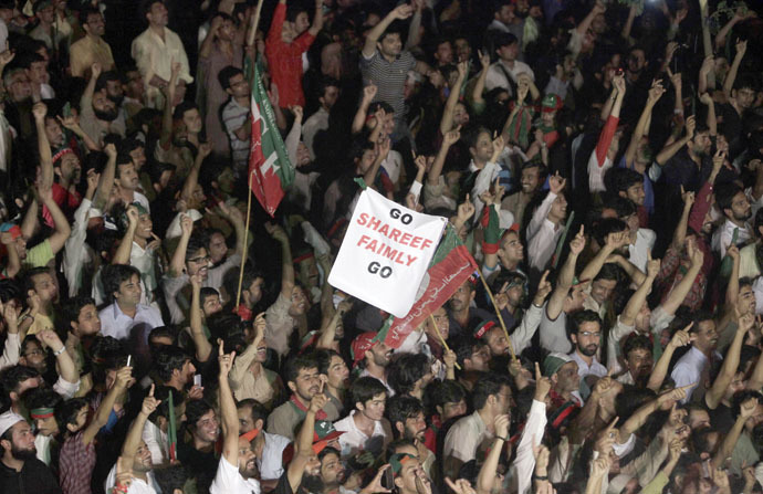 Supporters of Imran Khan, cricketer-turned-opposition politician and chairman of the Pakistan Tehreek-e-Insaf (PTI) political party, chant slogans while listening to their leader during the Freedom March in Islamabad August 17, 2014. (Reuters/Faisal Mahmood)