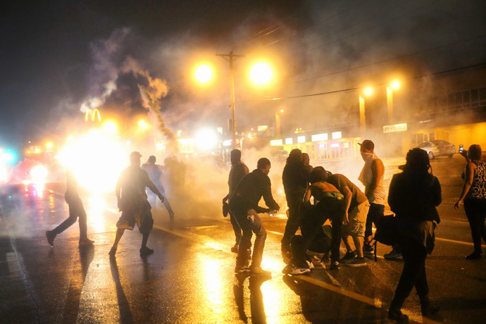 Police fire tear gas at demonstrators protesting the shooting of Michael Brown after they refused to honor the midnight curfew on August 17, 2014 in Ferguson, Missouri. (Scott Olson/Getty Images/AFP)