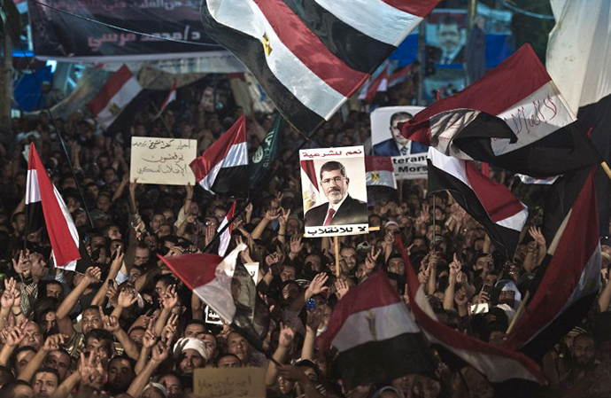 A file picture taken on August 12, 2013 shows members of the Muslim Brotherhood and supporters of Egypt's ousted president Mohammed Morsi as they take part in a sit-in protest outside the Rabaa al-Adawiya mosque in Cairo. (AFP Photo / Khaled Desouki)