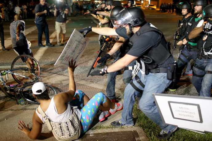 Police officers arrest a demonstrator on August 18, 2014 in Ferguson, Missouri. (AFP Photo / Getty Images / Joe Raedle)
