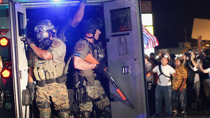 Police attempt to control demonstrators protesting the killing of teenager Michael Brown on August 18, 2014 in Ferguson, Missouri. (AFP Photo / Getty Images / Scott Olson)