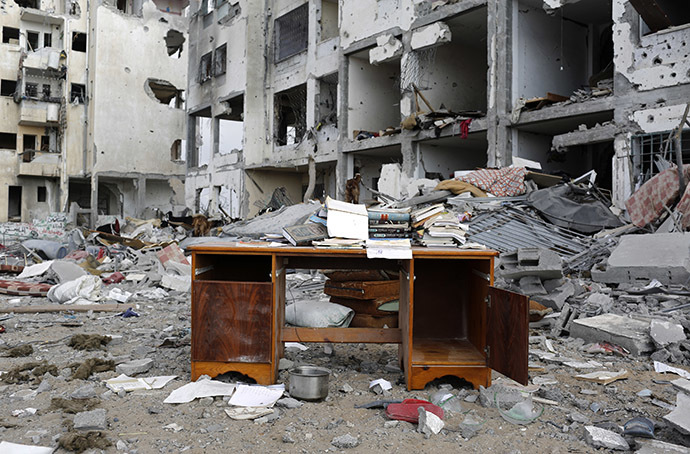 A desk sits amid the debris of buildings destroyed by what police said were Israeli airstrikes and shelling in the town of Beit Lahiya in the northern Gaza Strip (Reuters / Finbarr O'Reilly)