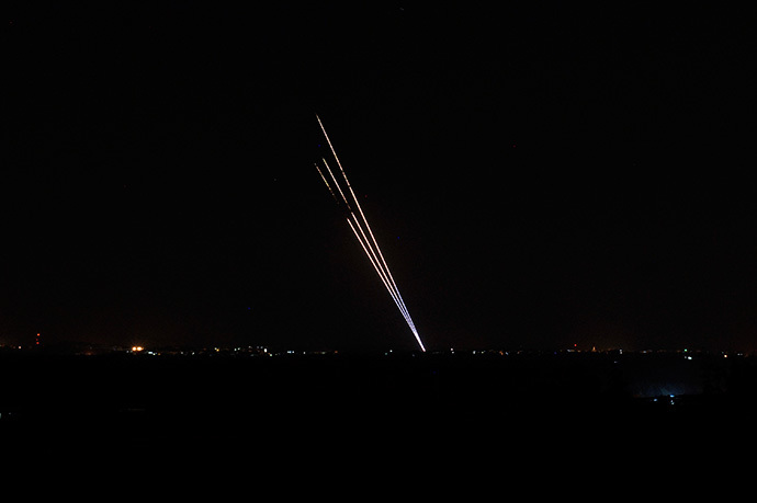Light trails made by rockets fired from the Gaza Strip mark the night sky from the Israel Gaza Border on August 19,2014. (AFP Photo / David Buimovitch)
