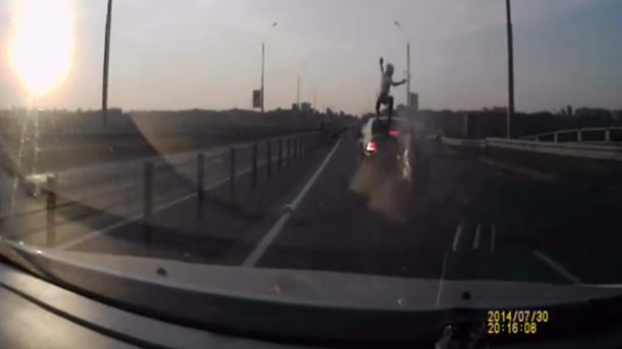 ​Biker survives rear-ending car by vaulting on to its roof (VIDEO)