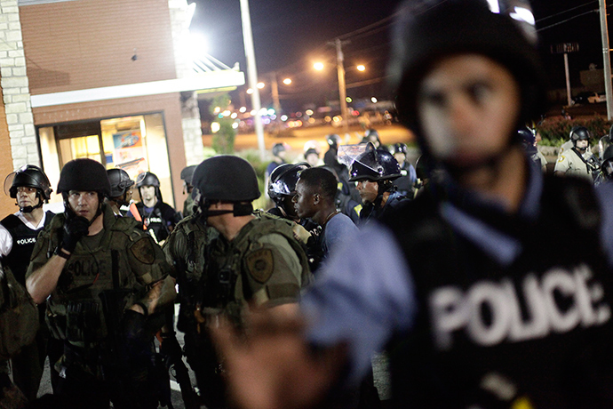 Police in riot gear detain a demonstrator (C) protesting against the shooting of Michael Brown, in Ferguson, Missouri August 19, 2014 (Reuters / Joshua Lott)