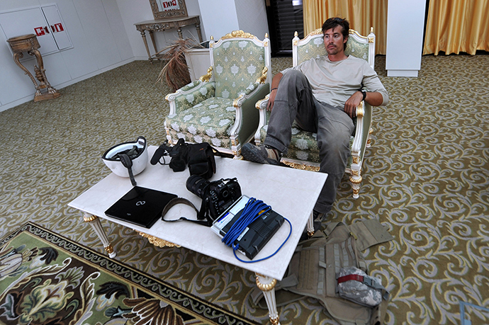File picture taken September 29, 2011 shows US freelance reporter James Foley resting in a room at the airport of Sirte, Libya (AFP Photo)